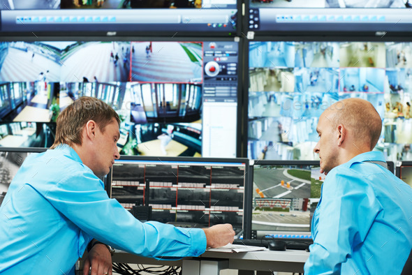 Security guards monitor security systems